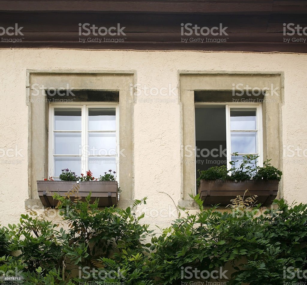 house facade detail with two old windows royalty-free stock photo