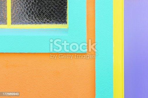 Retro Art Deco pastel home facade in blue orange yellow and lavender.  Miami Beach, Florida, 2007.