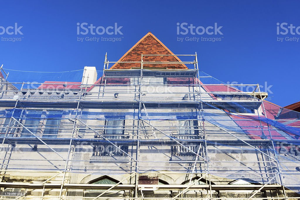 house facade restoration with scaffolding royalty-free stock photo