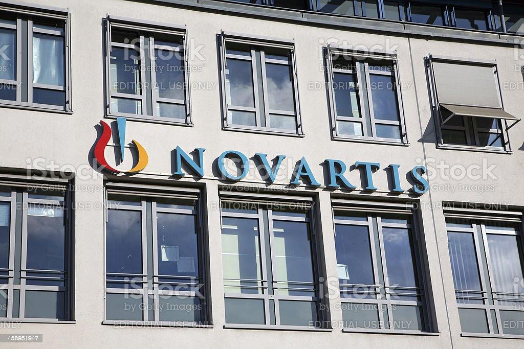 house facade with Novartis neon sign