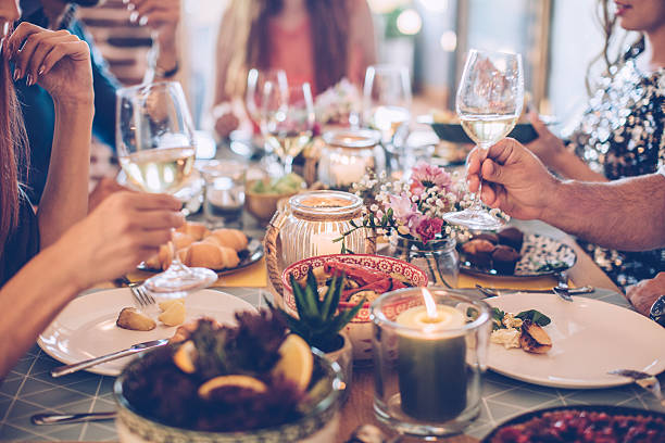 house feast for friends - gastronomía fina fotografías e imágenes de stock