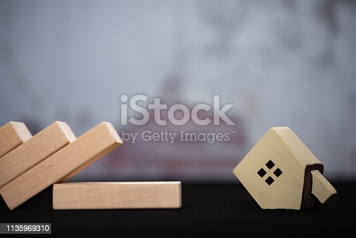 istock house fell down to the floor from domino base concept of real estate investment 1135969310