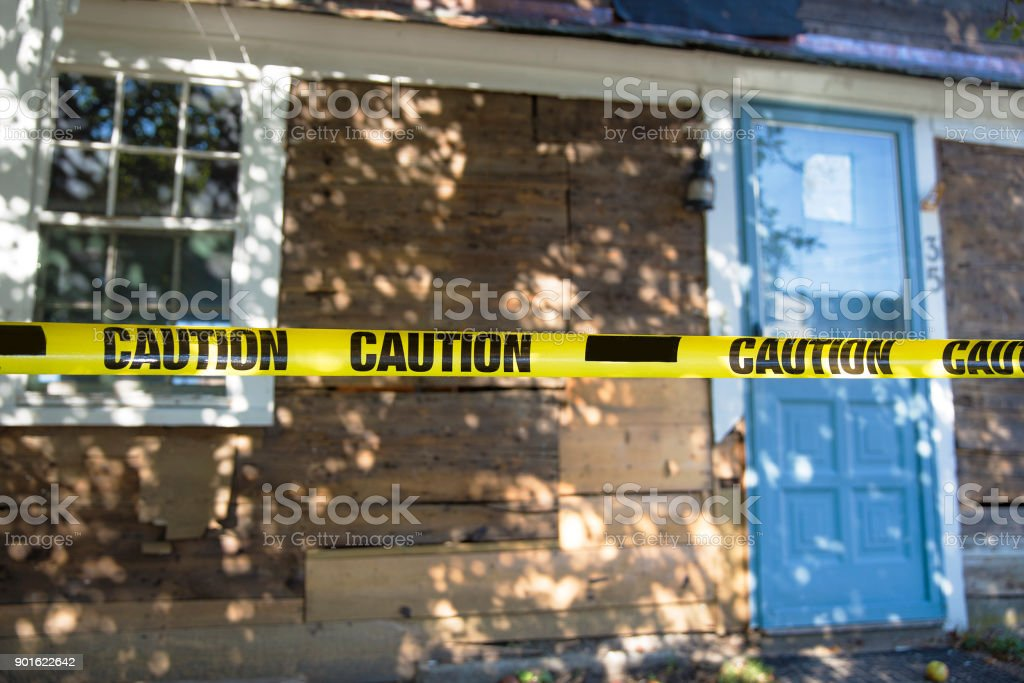 house fenced with a caution tape stock photo