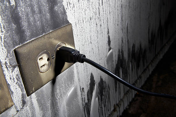 House Fire Series - Charred Electrical Outlet stock photo
