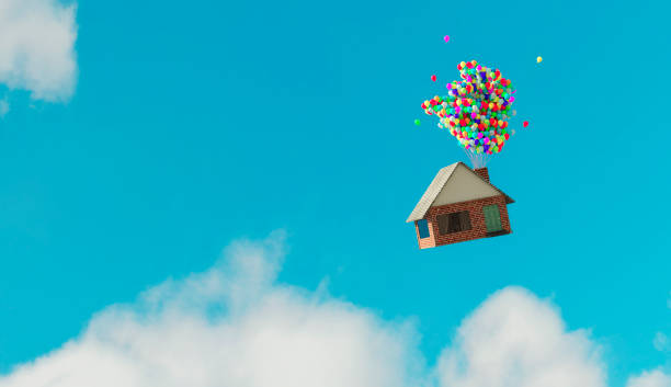 House flys away up in the air thanks to helium balloons stock photo