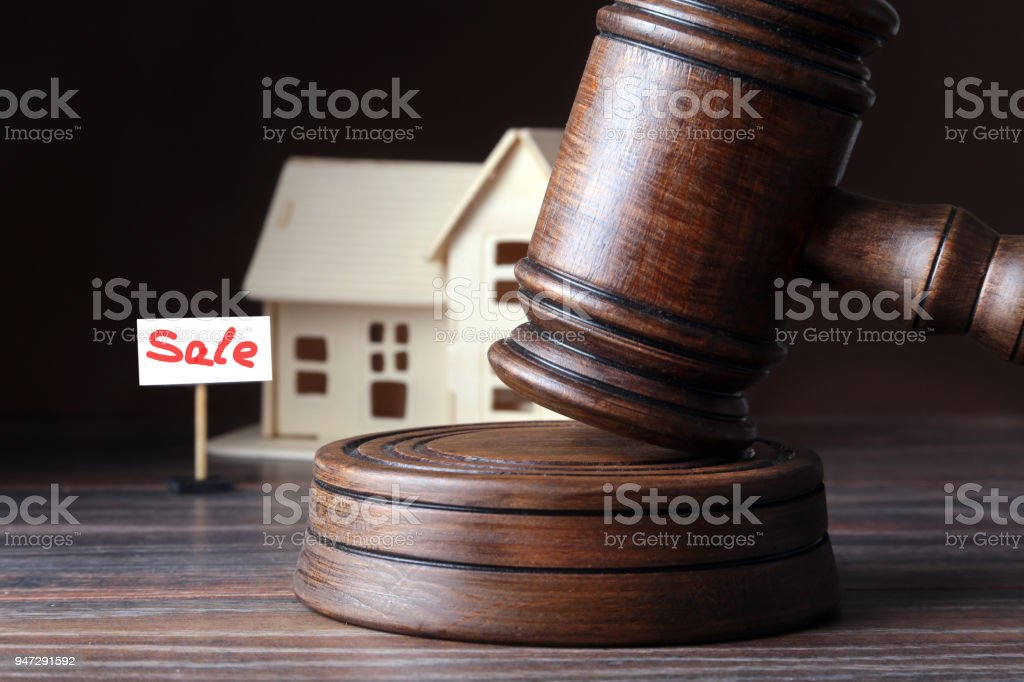 House for sale, auction hammer , symbol of authority and Miniature house . Courtroom concept. stock photo