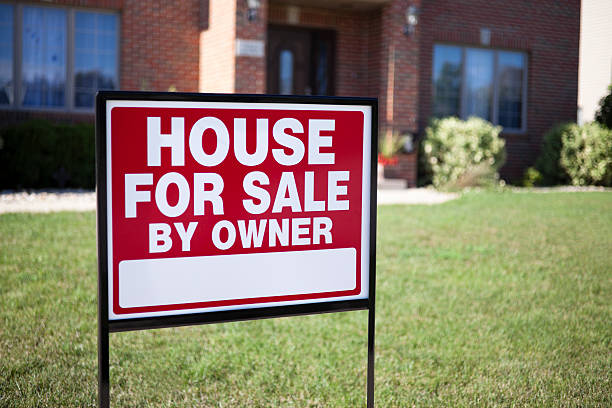 House For Sale By Owner Home Real Estate Sign stock photo
