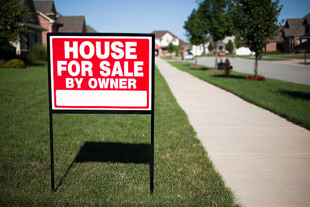 House for Sale by Owner Real Estate Sign stock photo