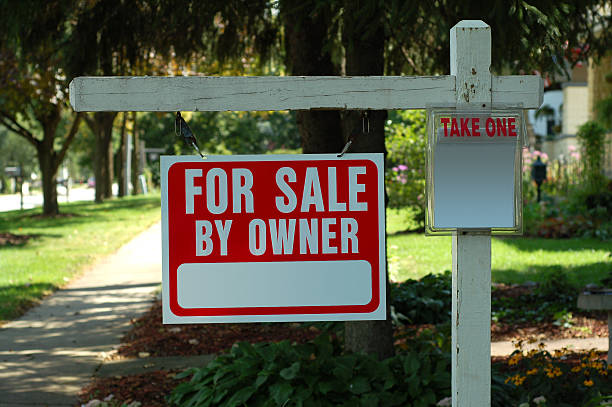House For Sale By Owner Real Estate Sign Wooden Post stock photo
