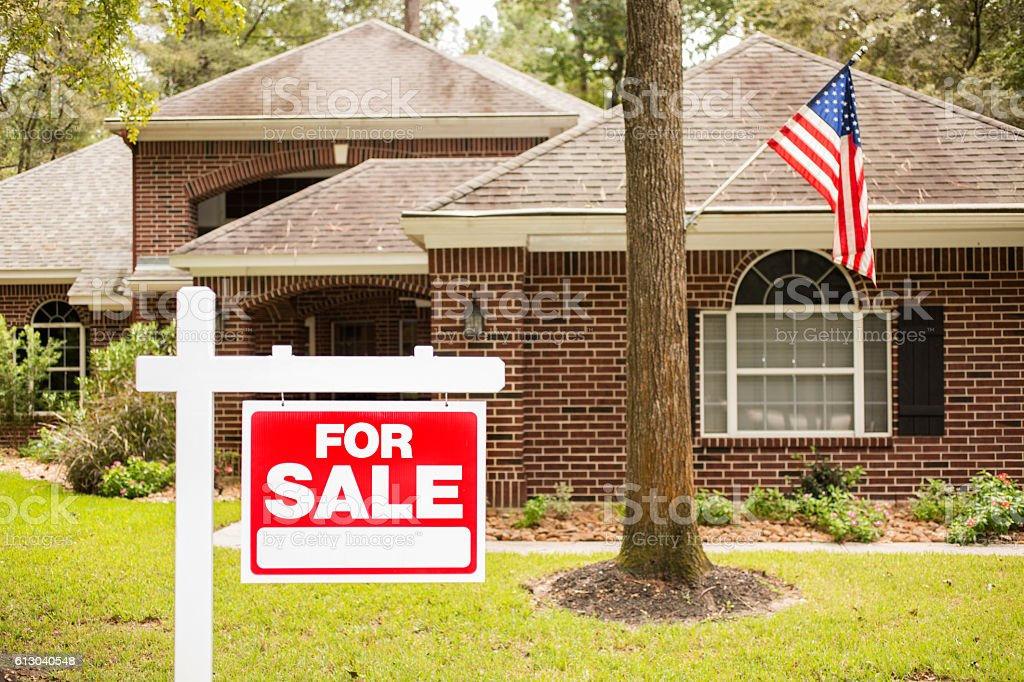 House for sale sign in front yard. royalty-free stock photo