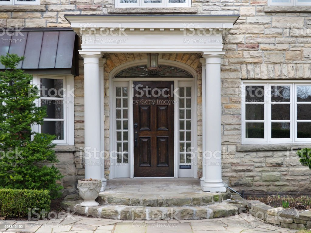 house front door with portico entrance stock photo