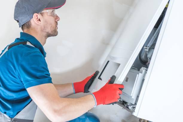 huis verwarming eenheid reparatie - krachtapparatuur stockfoto's en -beelden