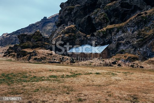 Beautiful wooden house hidden in the rocks in the Icelandic wilderness