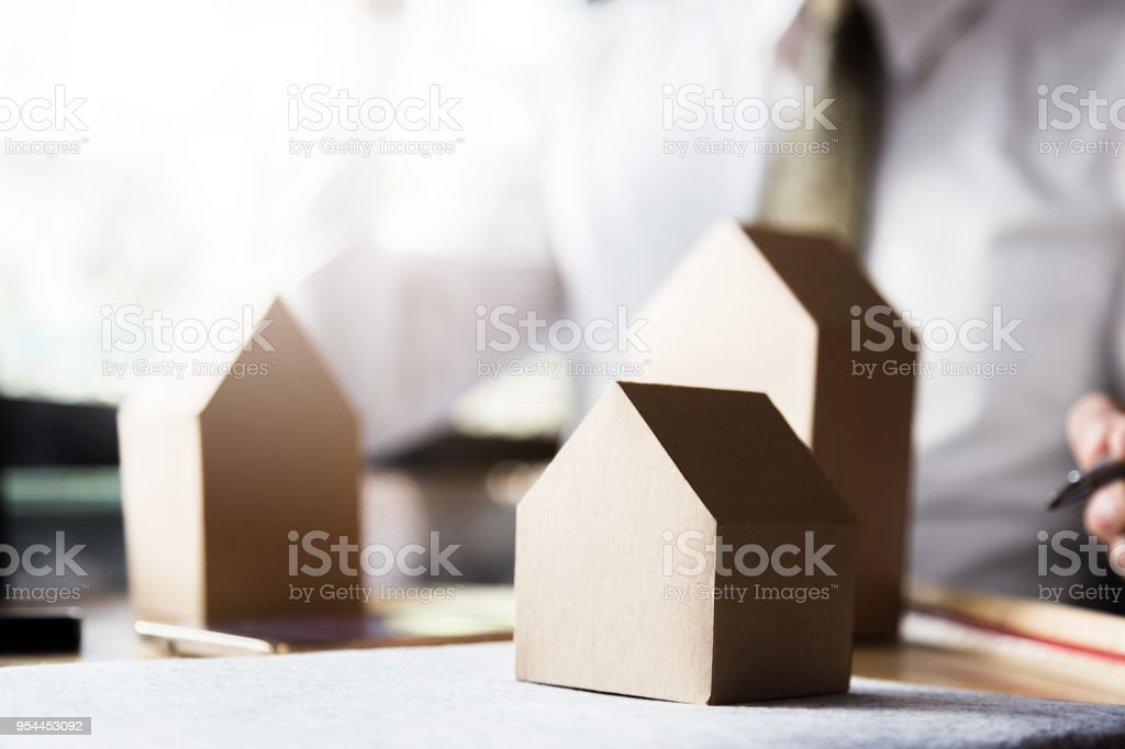 House Home Mortgage Concept With Business Man Hand With