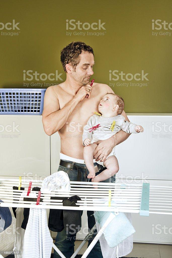 House Husband Doing Laundry royalty-free stock photo