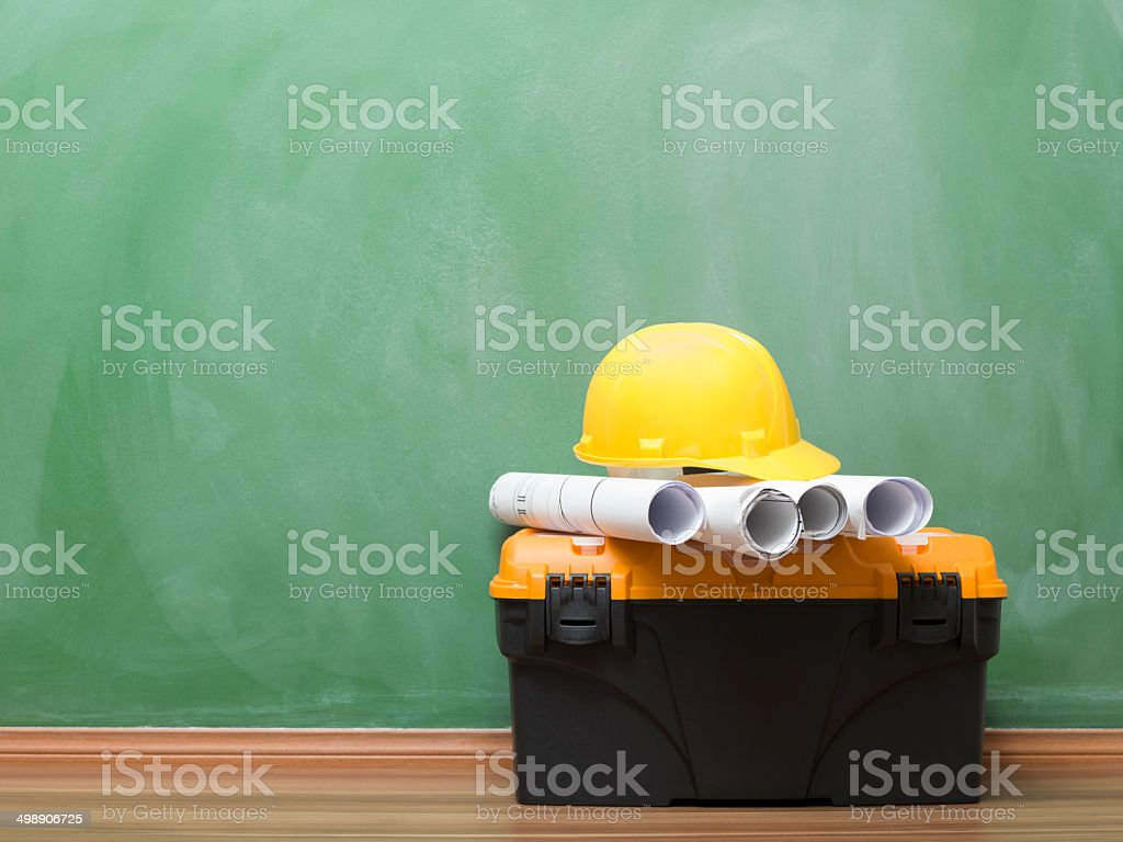 House improvement equipments and blueprints on blackboard stock photo