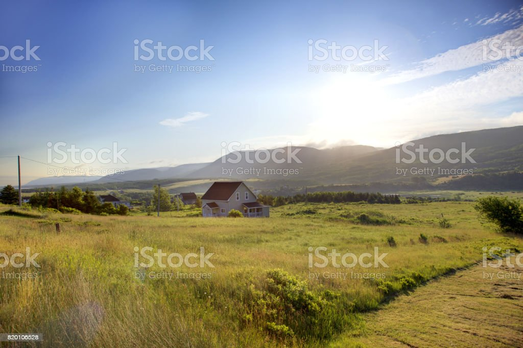 house in a valley stock photo
