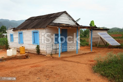 cuban village house with a solar panel beside