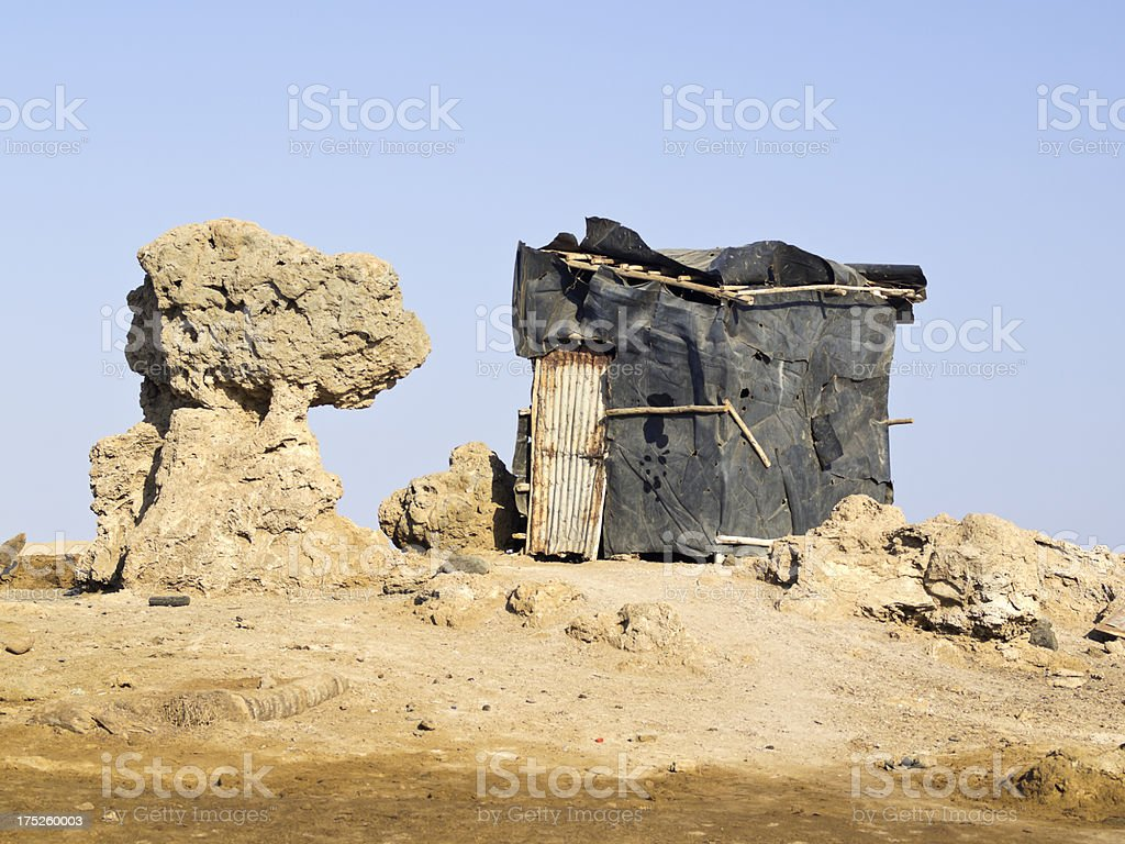 House in desert stock photo