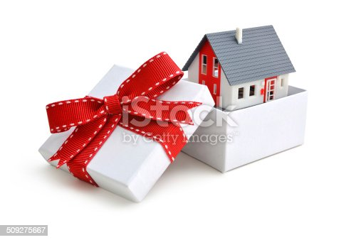 House model in gift box with red ribbon