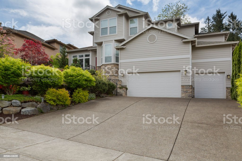House in North American suburban residential neighborhood two storey with 3 car garage stock photo