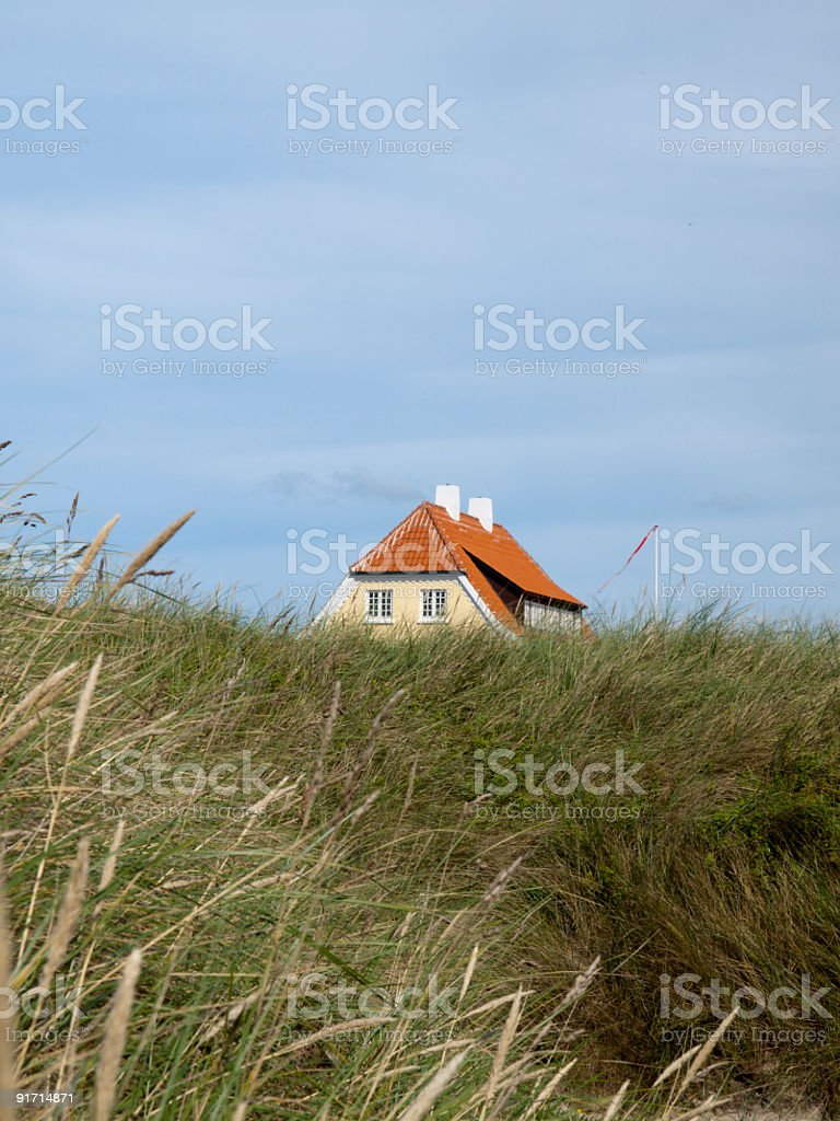 House in sand dunes at Løkken beach, Denmark. royalty-free stock photo