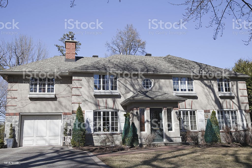 House in the spring with wrapped trees royalty-free stock photo