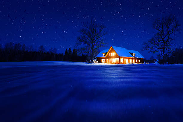 house in winter - warm house stock photos and pictures