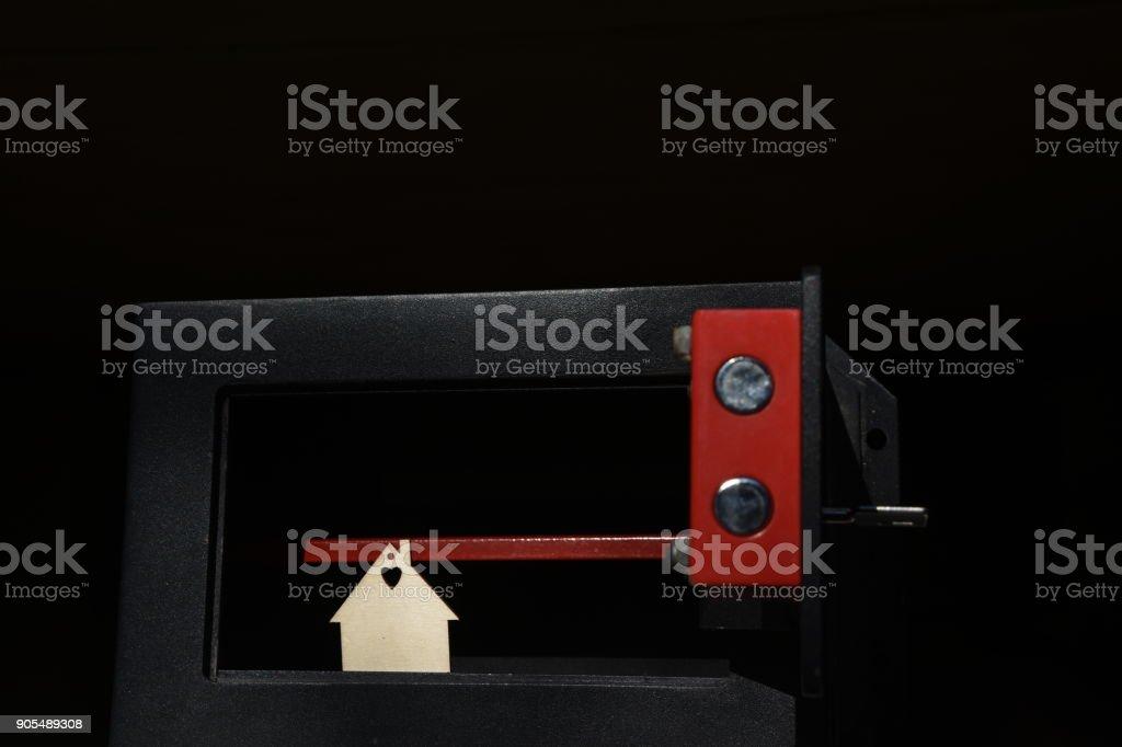 House inside safe box stock photo