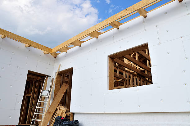 House insulation Insulation covering the walls of a unfinished house polystyrene stock pictures, royalty-free photos & images