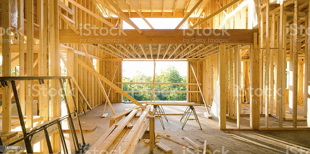 House interior during construction lit by sunset panorama royalty-free stock photo