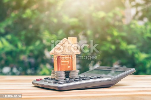 istock House is placed on the coin is on the calculator. planning savings money of coins to buy a home concept, concept for property ladder, 1168874570