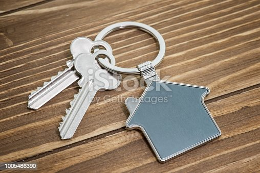 845342284 istock photo House Key And Key chain On Wooden Table 1005486390