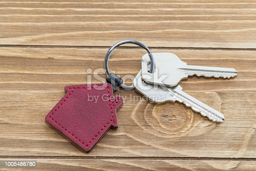 istock House Key And Key chain On Wooden Table 1005486780