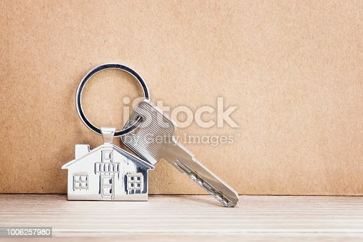 istock House Key And Key chain On Wooden Table 1006257980