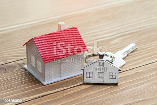 istock House Key And Key chain On Wooden Table 1006260630