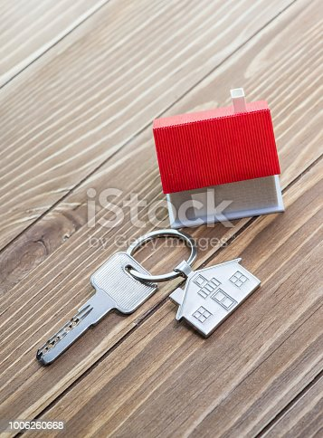 845342284 istock photo House Key And Key chain On Wooden Table 1006260668