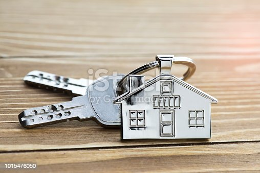 istock House Key And Key chain On Wooden Table 1015476050