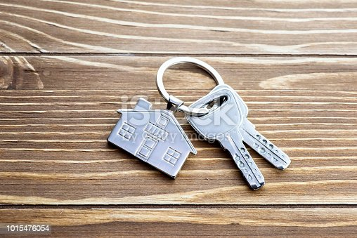 istock House Key And Key chain On Wooden Table 1015476054