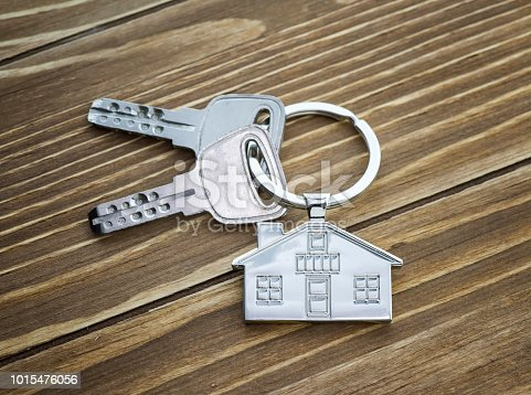 istock House Key And Key chain On Wooden Table 1015476056