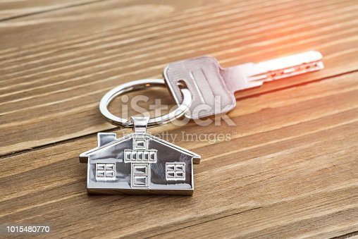 istock House Key And Key chain On Wooden Table 1015480770