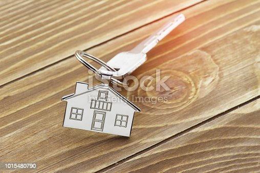 istock House Key And Key chain On Wooden Table 1015480790