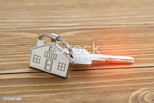 istock House Key And Key chain On Wooden Table 1015481060