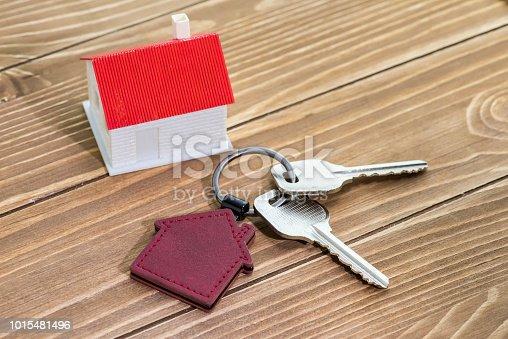 istock House Key And Key chain On Wooden Table 1015481496