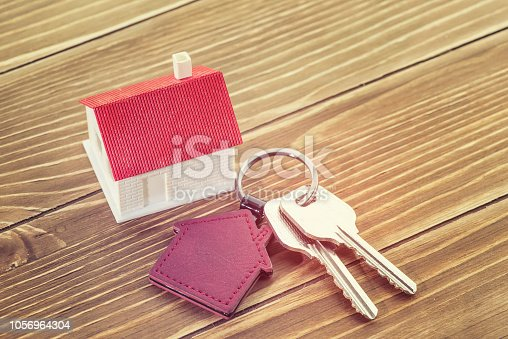 845342284 istock photo House Key And Key chain On Wooden Table 1056964304
