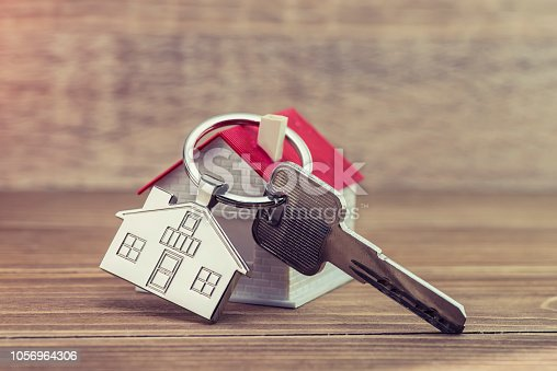 istock House Key And Key chain On Wooden Table 1056964306
