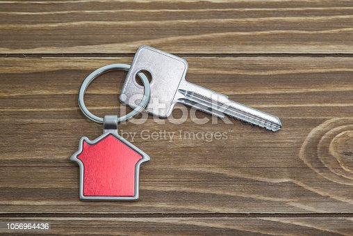 845342284 istock photo House Key And Key chain On Wooden Table 1056964436
