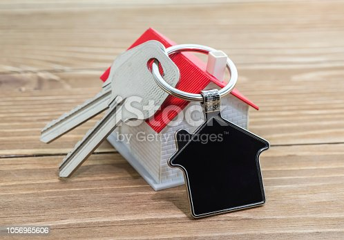 845342284 istock photo House Key And Key chain On Wooden Table 1056965606