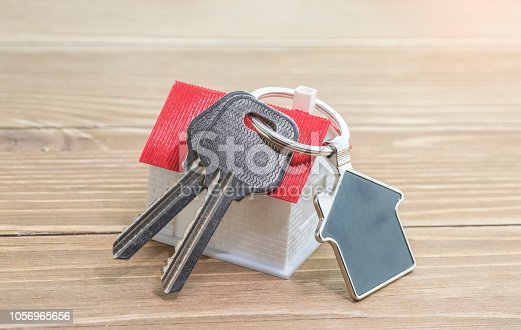 845342284 istock photo House Key And Key chain On Wooden Table 1056965656