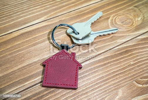 istock House Key And Key chain On Wooden Table 1056965740
